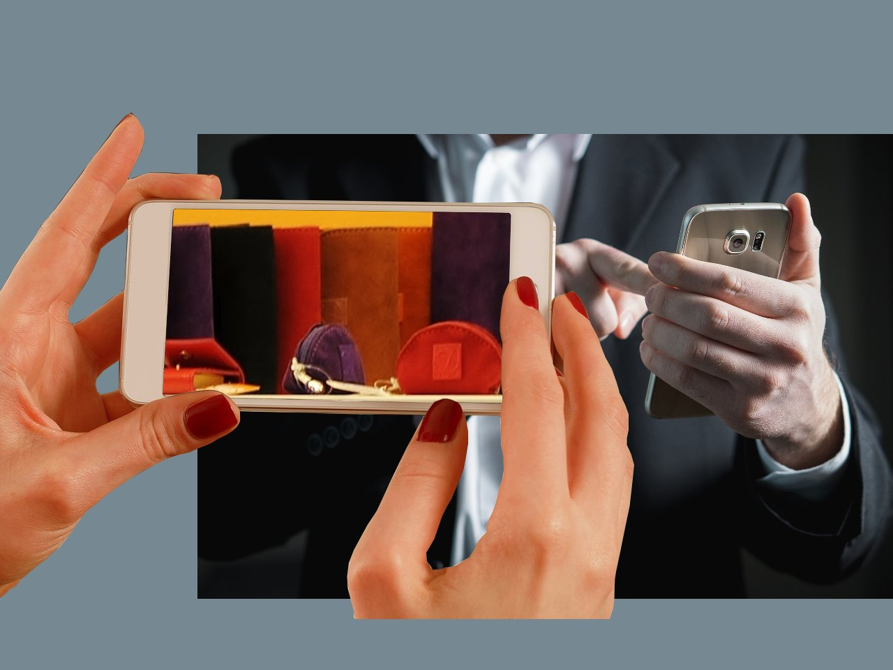 Manos con teléfonos móviles mostrando la web